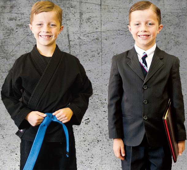 Two boys dressed in ninja outfit and suit