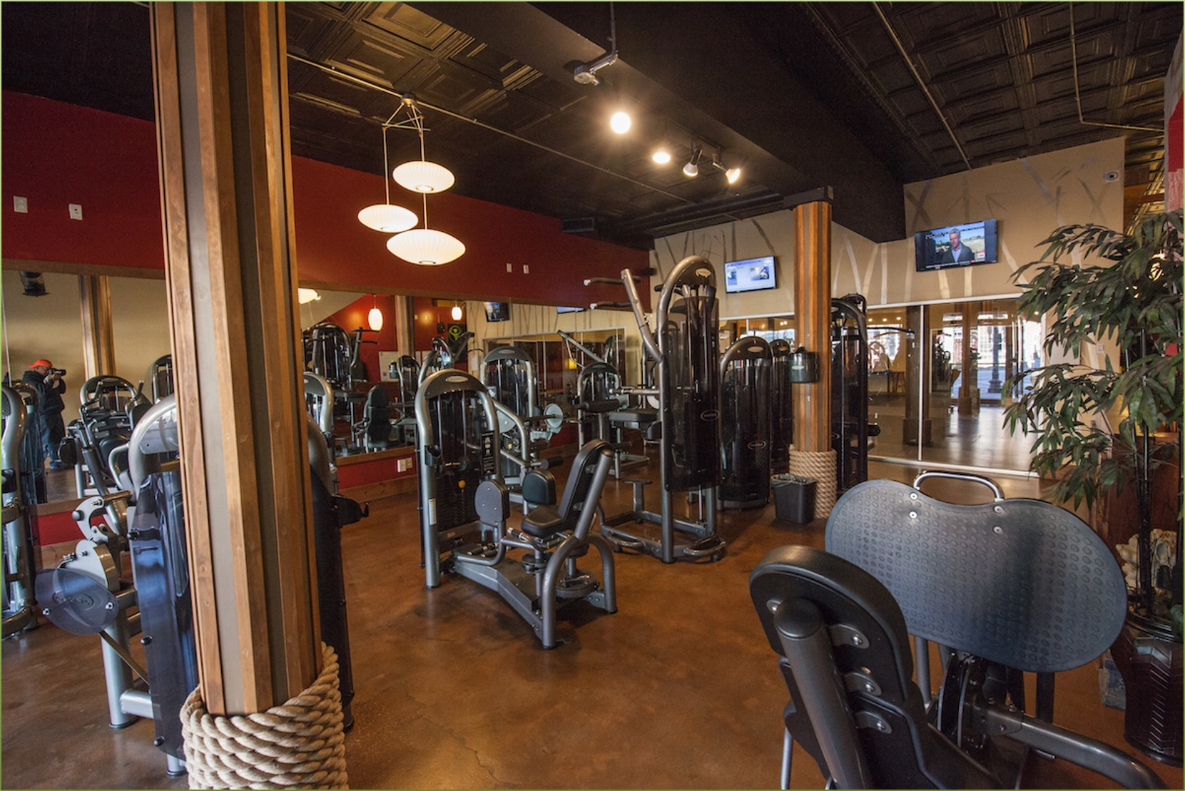 Gym with equipment and tvs
